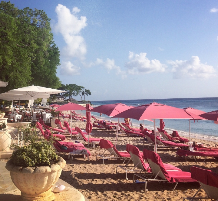 pink beach chairs at sandy lane
