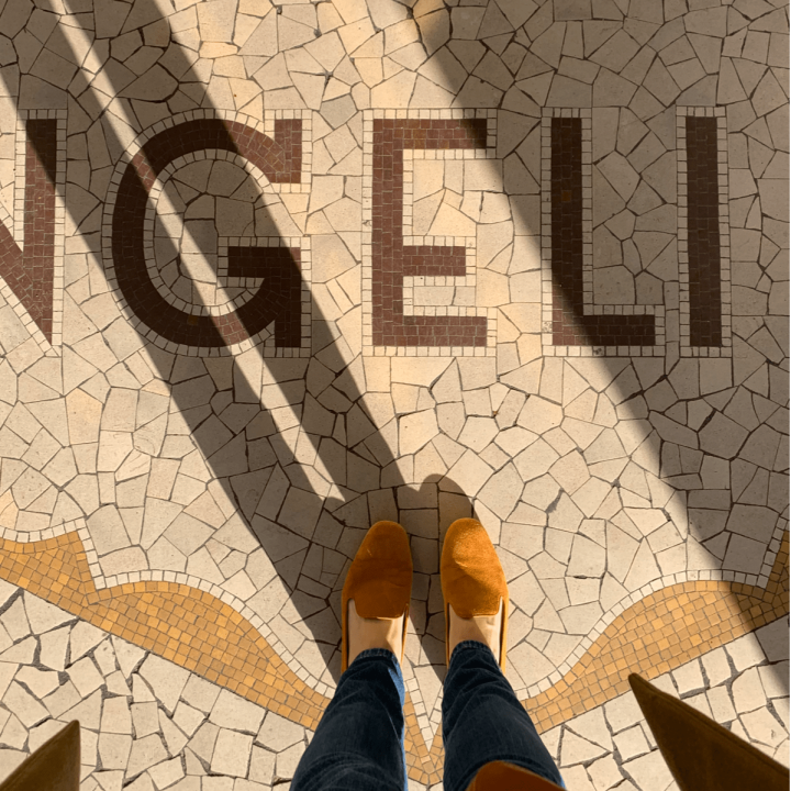 at the tiled floor outside Angelina Cafe